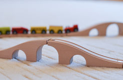 Wooden toy train on the tracks and empty brige in front Stock Photography