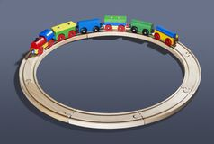 Wooden toy train on tracks Royalty Free Stock Photo