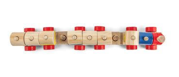 Wooden toy train up view with colorful blocs isolated over white Royalty Free Stock Photo