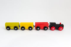 Wooden toy train on white background Stock Photos
