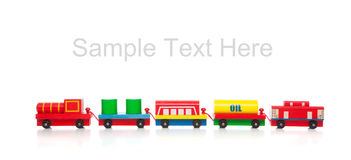 Wooden toy train on white with copy space. A wooden toy train on a white background with copy space Royalty Free Stock Image
