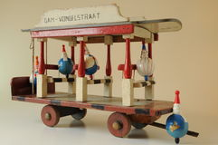 Wooden toy tram. With clown dolls as passengers Stock Photos