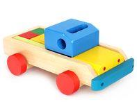 Wooden toy on a white background. Car royalty free stock photo