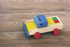 Wooden toy on a wooden background. Car.  royalty free stock images