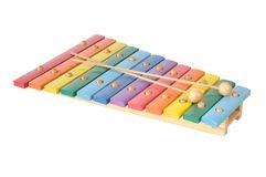 Wooden toy xylophone. Rainbow colored wooden toy xylophone against white background Royalty Free Stock Images