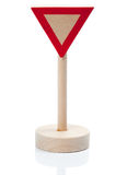Wooden toy yield sign (Vorfahrt achten). Wooden traffic yield sign,  on white with reflection on the stand Stock Images