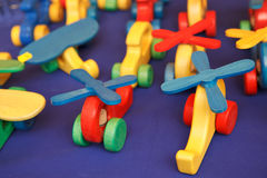 Wooden toys. Colorful wooden toys on blue fabric royalty free stock photos