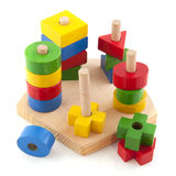 Wooden toys. As a puzzle with different shapes stock photos