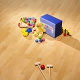 Wooden toys on bright parquet Royalty Free Stock Photo