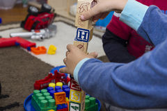 Wooden toys with childres stock images