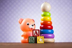 Pile of toys, collection on wooden background royalty free stock images