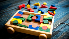 Wooden toys for didactic and educational purpose on a play field. Geometrical and building wooden toys for children for didactic and educational purpose stock images