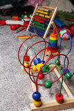 Wooden toys on the floor Royalty Free Stock Images