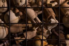 Wooden toys over metal bars. Conceptual image Royalty Free Stock Photos