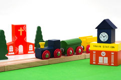 Wooden toys of railway station, rails and train. With a church and trees at the background Royalty Free Stock Photography