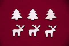 Wooden toys on red background. Wooden elk. Deer's stock photography