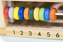 Wooden toys scores from one to six. Of the colored rings, toys to learn and play with shapes  number and color Royalty Free Stock Photography