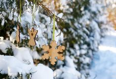 Wooden toys on a snow-covered Christmas tree Stock Photo