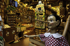 Wooden toys store with Pinocchio Stock Photo