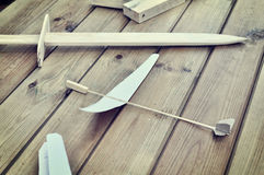 Wooden toys - sword and aircraft Stock Photo