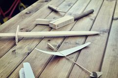 Wooden toys - sword and aircraft Royalty Free Stock Photo