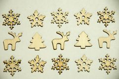 Wooden toys on white background. Firs, snowflakesdeers and stock photos