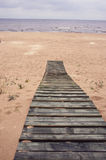 Wooden track on Baltic sea beach in Jurmala Royalty Free Stock Image