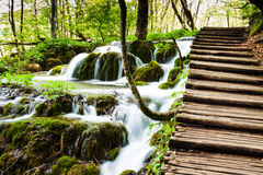 Wooden track near a forest waterfall in Plitvice Lakes National Stock Images