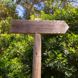 Wooden track road sign in Mediterranean Stock Images