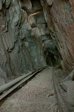 Wooden tracks in old mine Royalty Free Stock Image