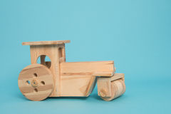 Wooden Tractor on blue background Royalty Free Stock Photo
