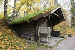Wooden traditional Finnish sauna in autumn. Outdoor royalty free stock images