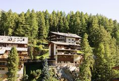 Wooden traditional Swiss chalet in mountains at Zermatt. Switzerland in summer Stock Photo