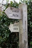 Weathered trail markers for a path royalty free stock image