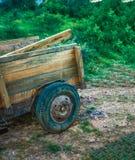Wooden trailer in the garden. Wood stock image