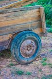 Wooden trailer in the garden. Wood royalty free stock image
