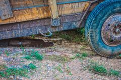 Wooden trailer in the garden. Wood royalty free stock photography