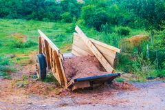 Wooden trailer in the garden. Wood stock photography
