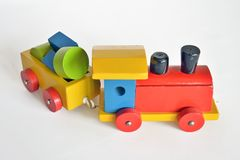 Wooden train, baby toy. Wooden train with locomotive and wagons, assembled with colored blocks,  on white background. part of a series Royalty Free Stock Photos