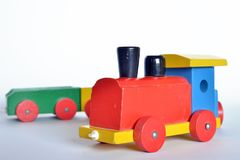 Wooden train, baby toy. Wooden train with locomotive and wagons, assembled with colored blocks,  on white background. part of a series Royalty Free Stock Photography
