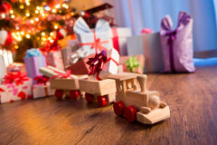 Wooden train with christmas gift Royalty Free Stock Photos
