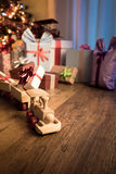 Wooden train with christmas gift Royalty Free Stock Photography