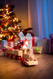 Wooden train with christmas gift Stock Photography