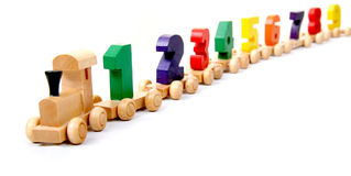 Wooden train of numbers. Wooden educational toy train of number nil to nine on the wheels stock photos