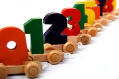 Wooden train of numbers. Wooden educational toy train of number nil to nine on the wheels Stock Image