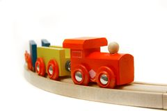 Wooden train over white Stock Images
