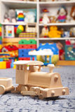 Wooden train in the play room. And many toys Royalty Free Stock Photos