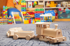 Wooden train in the play room. And many toys Stock Photography