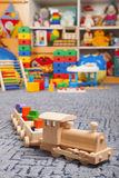 Wooden train in the play room Royalty Free Stock Photos