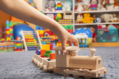 Wooden train in the play room Stock Photos